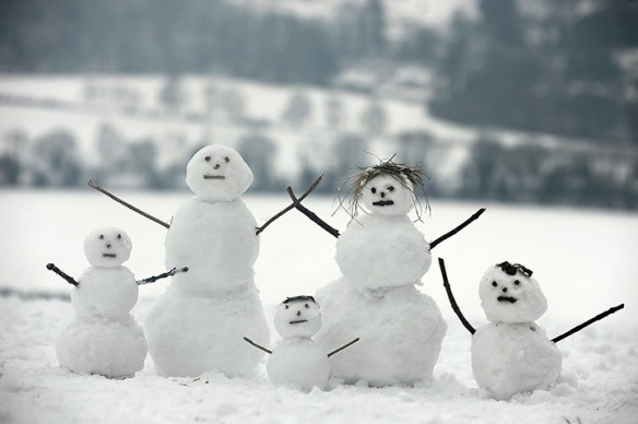 Dorking:  A family of snowmen sit on Box Hill